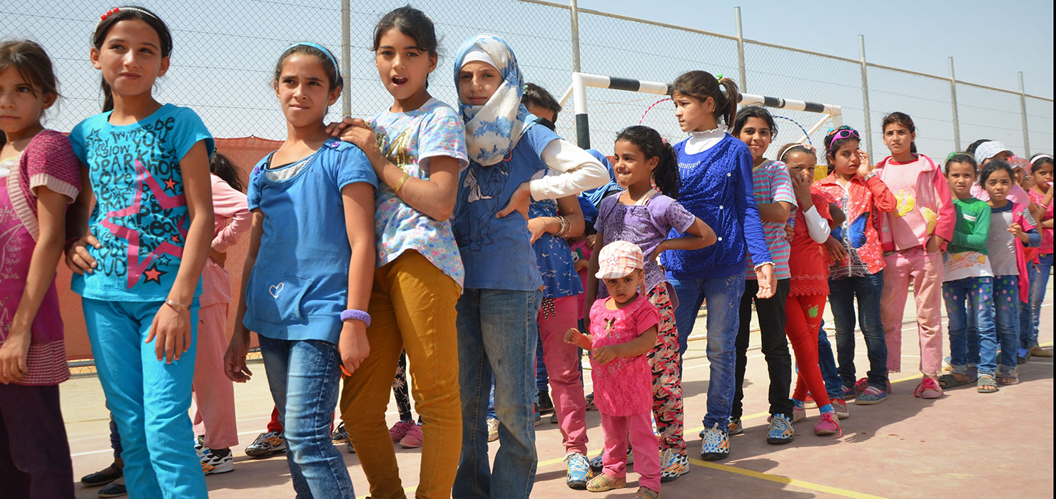 Girls standing in a row at Azraq Refugee Camp